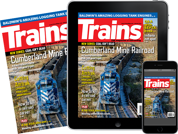 A physical copy of Trains alongside a tablet and mobile phone featuring covers of the issue