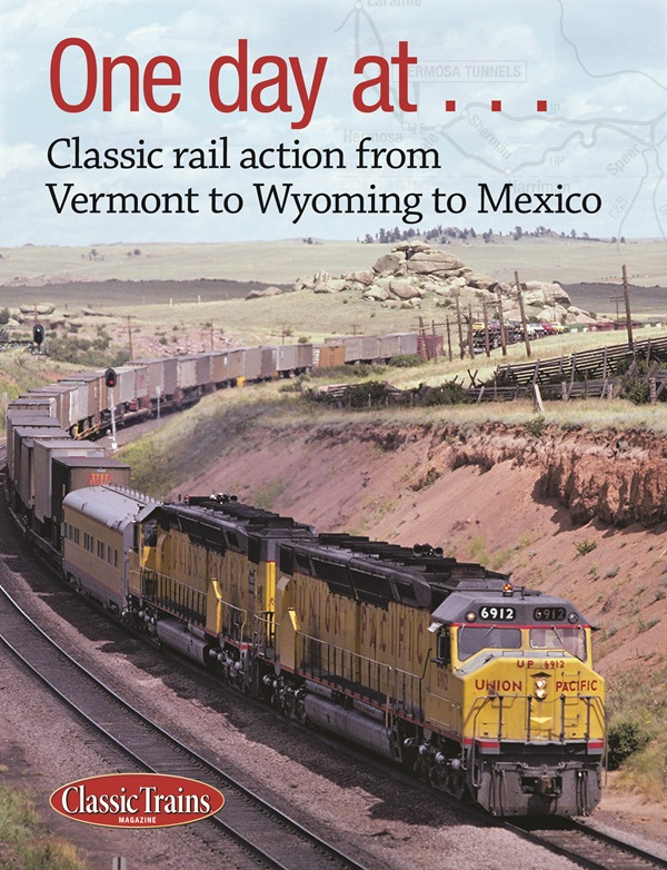 The cover shows a photo of a diesel freight train