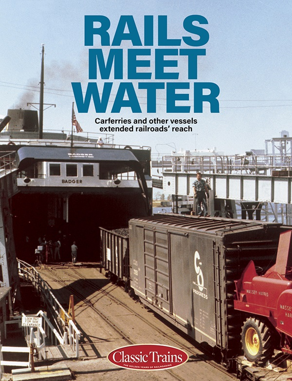 The cover shows a vintage color photo of box cars on a ferry