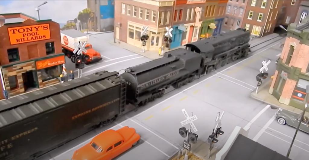 Model locomotive in a city scene