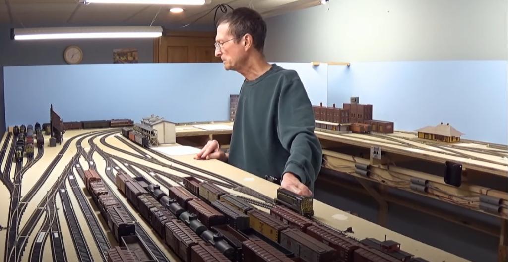 Man watching model trains