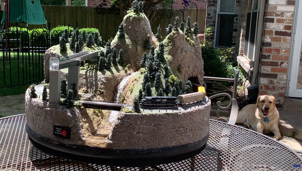 "Battery-powered 24"" N-scale model railroad with waterfall"