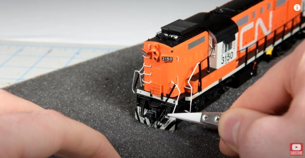 Removing shell of model locomotive