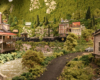 Two steam locomotives powered trains meet in a mountainous, forested landscape bracketed by rustic late-19th century wood or brick buildings. Appalachian.