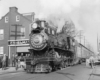 Steam locomotive with passenger train on street trackage