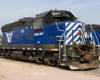 A blue train parked in a rail yard