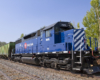A blue train parked on the tracks