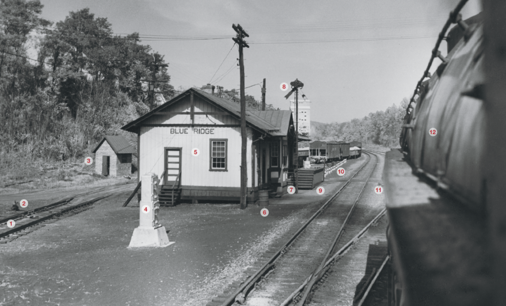 View from the cab of a Norfolk & Western 2-6-6-4 steam locomotive on an eastbound freight in 1953 at Blue Ridge, West Virginia. The photograph is black and white with 12 numbered callouts.