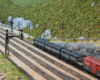 Three matching black-and-grey locomotives haul a train on a multi-track mainline in a verdant, mountainous scene.