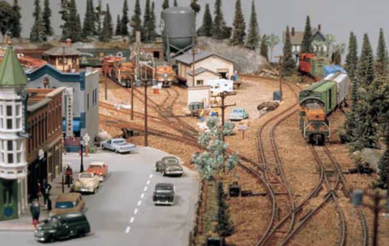 A lengthwise view of Dan Culp's layout with a look down a ladder track into the yard.
