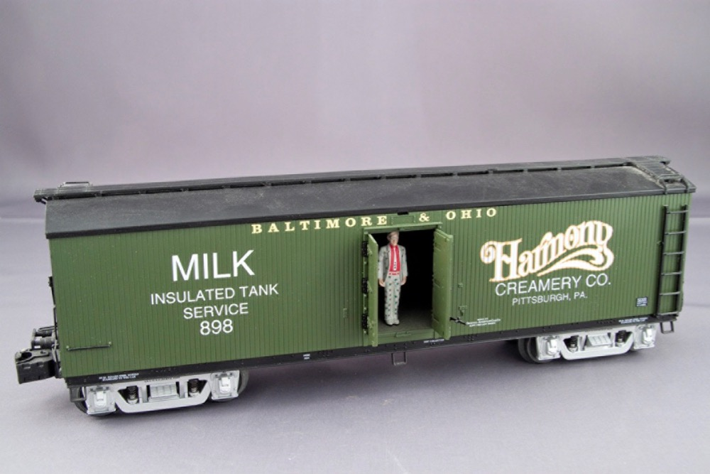A green painted milk car lettered for the Baltimore & Ohio.