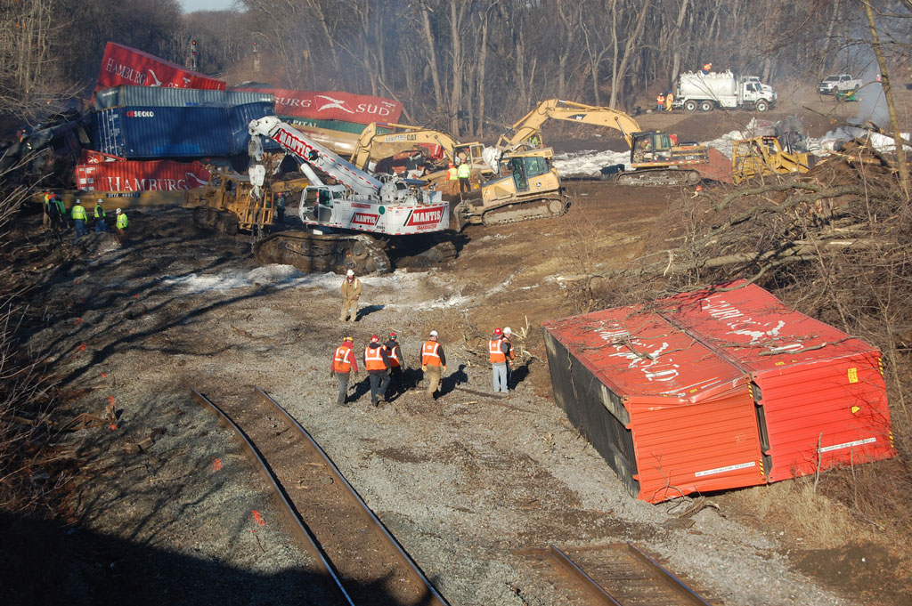 Workers cleaning up a train derailment