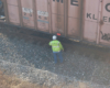 A worker walking up to a storage container