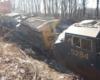 A close up picture of a derailed train