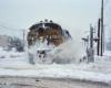 A train plowing through snow