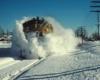 A train plowing through the snow
