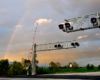 A rainbow over a railroad crossing