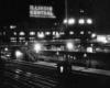 a passenger train parked at a station at night