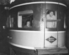 A couple of women looking out the back of an observation car