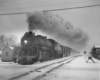 a steam passerger train on a winter day