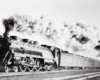 A black and white photo of a train with a lot of white smoke coming out of it
