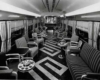 A black and white photo of the inside of an empty buffet car