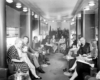 a group of people sitting around an observation car
