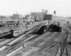 freight and passenger trains in a train yard