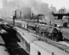 Steam passenger train departing a station