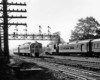 A black and white photo of two commuter trains passing each other