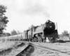Steam locomotive on passenger train in curve