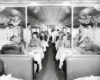 Patrons seated in dining car