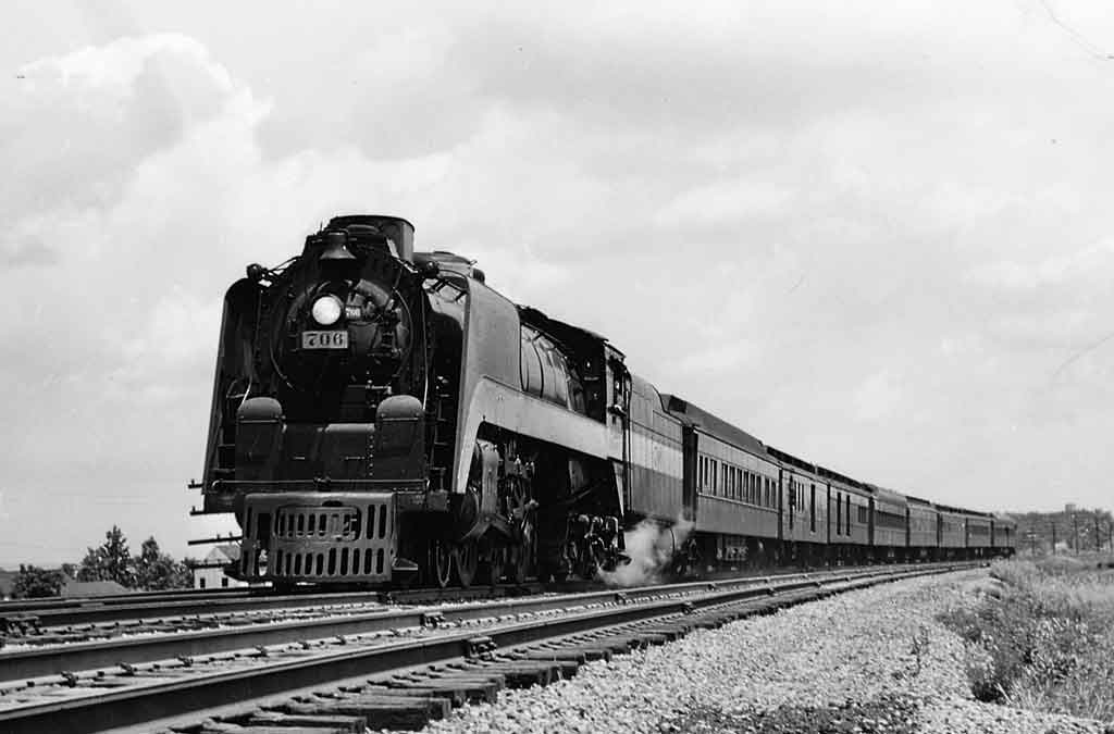 A black and white photo of a train on the tracks