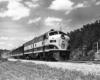 Diesel locomotive with passenger train