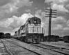 Diesel locomotive with passenger train in freight yard