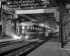 End of streamlined passenger car in station at night