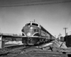 Diesel locomotives with passenger train approaching diamond crossing