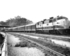 Diesel locomotive with six-car passenger train on curve