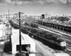 A black and white overhead photo of a handful of trains at a terminal