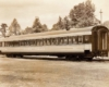 A photo of a passenger car sitting on the tracks