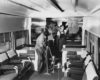 people cleaning the interior of a couch lounge car