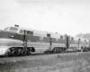 Diesel locomotives hauling a passenger train.