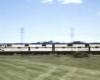 Diesel locomotives haul a passenger train.