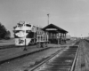 a diesel passenger train at a depot