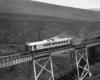 a passenger train going over a bridge