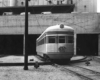 A black and white photo of a passenger car
