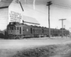 Motor car with two trailers by grain elevator