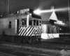 Motor car by station at night
