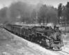 Steam locomotive with passenger train at speed on curve