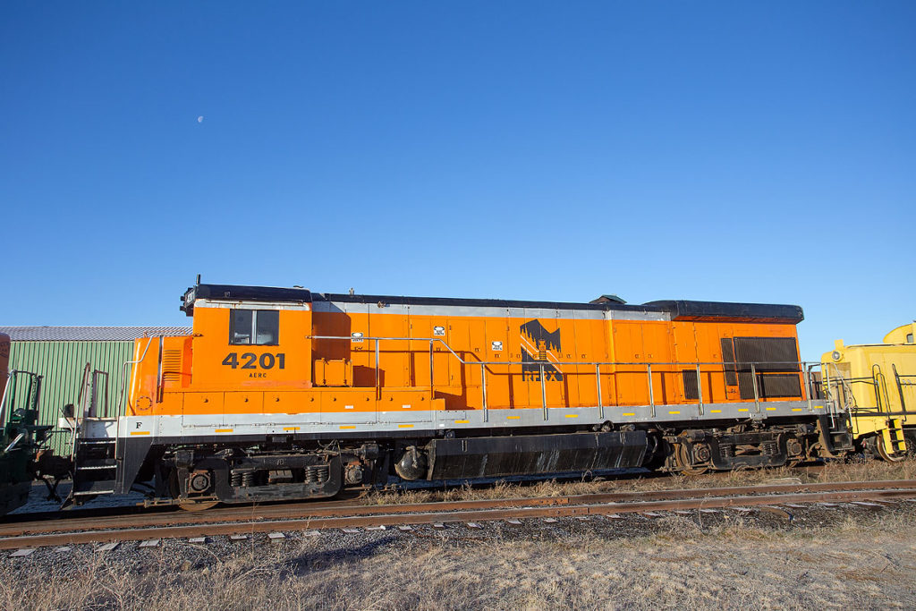 An orange-painted locomotive.